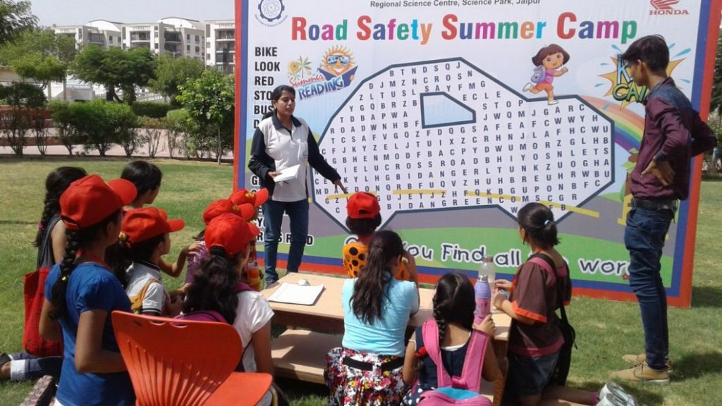 Honda Trainer giving Road Safety Lessons to children at Honda Road Safety Summer Camp - Honda Traffic Training Park - Science Park - Jaipur