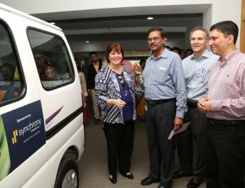 Ms Margaret Keane SynchronyFinancial Handing the Key of Van to LVPEI