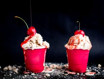 Ice Cream Sundae with crushed coffee meringue and strawberry sauce