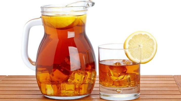Jug-of-cold-summer-iced-drink-with-lemon-tea-with-slice-lemon-in-pitcher