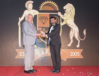 Navrattan Kothari - Chairman KGK group receving the Excellence award - Rashmin Donda - President Sarjan group