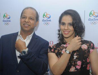 PH Narayanan - Brand Manager of OMEGA India and Saina Nehwal posing in Omega constellation watch