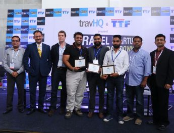 Winners of Travel Startup Knockdown with the winners and judges