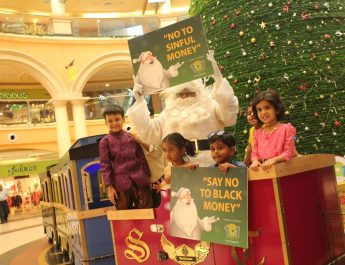 Santa posing with the kids and spreading the message Say YES to white money at Growels 101 Mall - Kandivali east