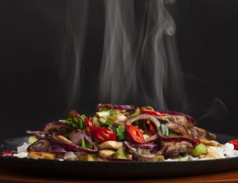 Barbeque Nation - steaming chicken sizzler with noodles - Smokin Sizzlerz