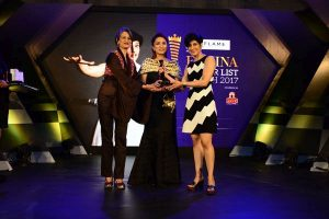 Beauty expert Ashmin Munjal - designer Anu PD presenting the award to stand-up comedienne Neeti Palta at Femina Power List North 2017