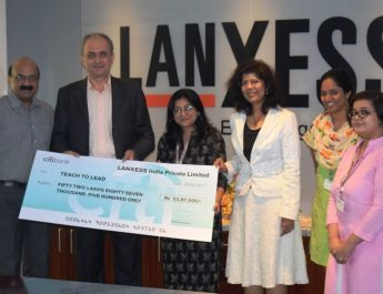 Dr Jacques Perez - MD and Country Representative - LANXESS handing over the cheque to Dimple Gujral CFO - Teach For India at LANXESS House
