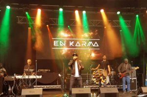 En Karma during a live stage performance