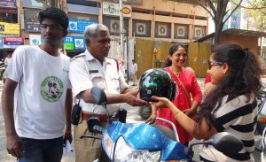 Happy bikers after receiving the helmets - World Head Injury Day