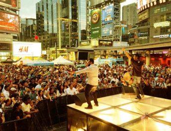 Inder Kooner - vocalist and Karm Cooner - dhol of En Karma during a live stage performance
