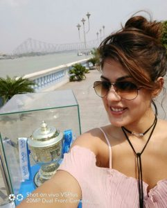 Rhea Chakraborty takes a selfie with the much awaited VIVOIPL Trophy in Kolkata