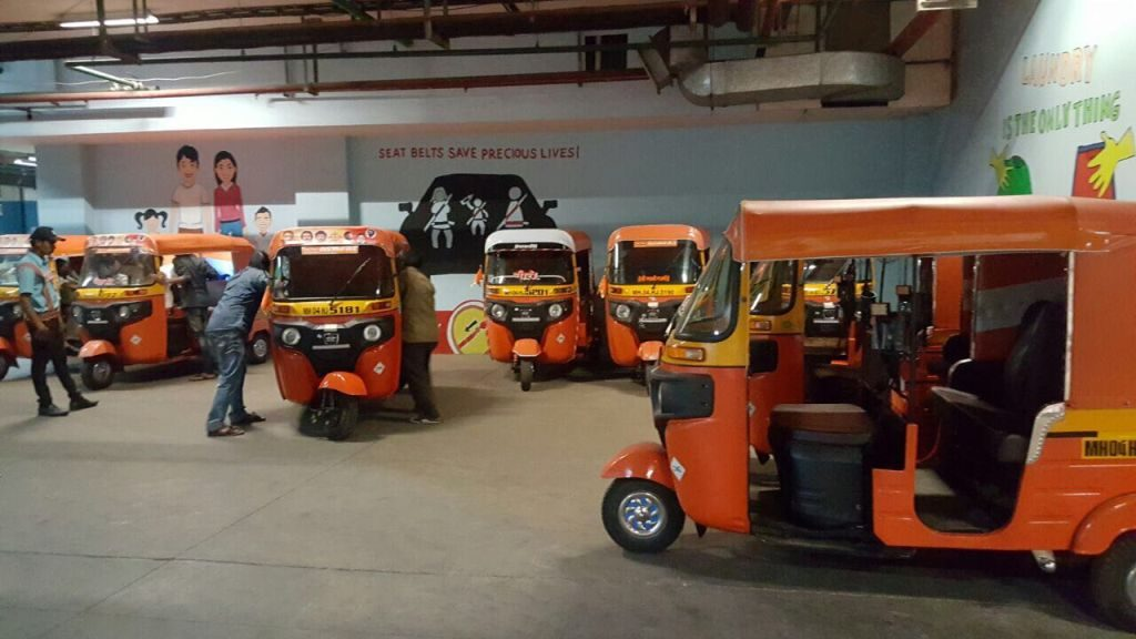 Special Orange colored rickshaw launched at Viviana Mall driven by Women Rickshaw Drivers