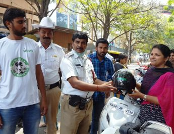 Traffic Police Giving away the helmets - World Head Injury Day