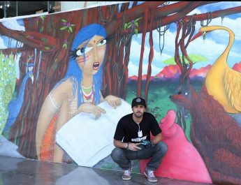 Brazilian Graffiti Artist Michael Deviswith his artwork at Stratford USA India Campus in Noida