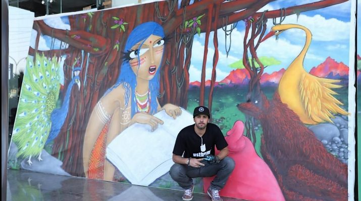 Brazilian Graffiti Artist Michael Deviswith his artwork at Stratford USA India Campus in Noida