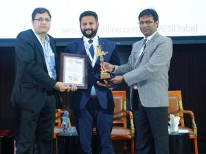 Naveen KM - MD Trio World Academy receiving award for Global Collaborative Learning Environments at World Education Summit Dubai