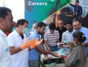 BBMP Workers and particpants collecting masks and gloves during the Clean Bengaluru campaign - Omega Healthcare