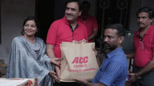 Neeraj Akhoury - MD and CEO - ACC Cement handing over relief materials in Kerala flood relief