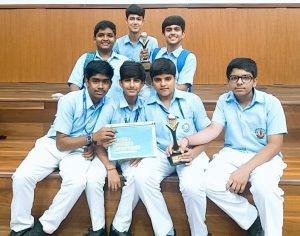 Students of Blue Bells Public School with Industrial Design Championship Trophy and certificate