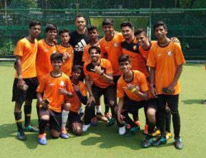 Former Indian Footballer Robin Singh with local kids from Dharavi at the adidas Tango League in Mumbai