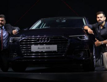 Virat Kohli - captain of Indian cricket team with Balbir Singh Dhillon - Head of Audi India with the new Audi A6