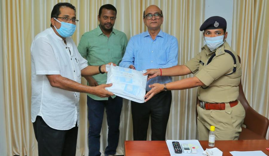 George Alexander Muthoot - MD - Muthoot Finance handing over masks - gloves and sanitisers to Kochi Police Commissioner