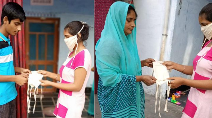 Sonu Gujar distributing mask in her village