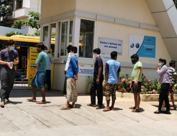TRIO World Academy management distributes over 250 food packets in North Bangalore daily