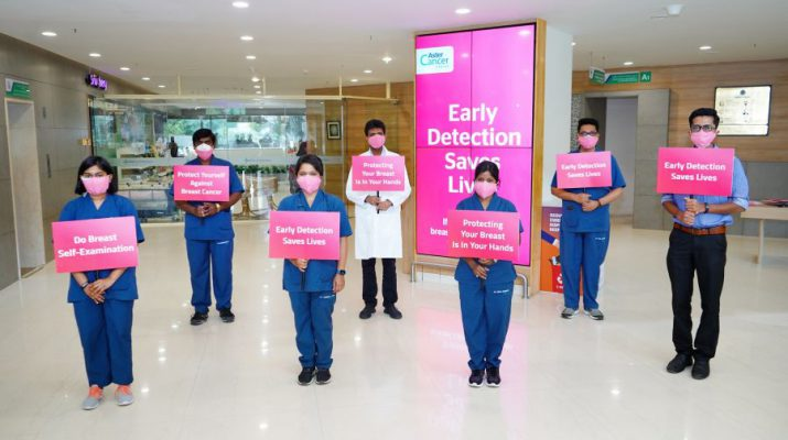 Aster CMI Doctors Holding Pink Placards