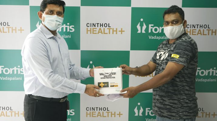 A person getting post-vaccine sensitization kit by Fortis Hospital Staff